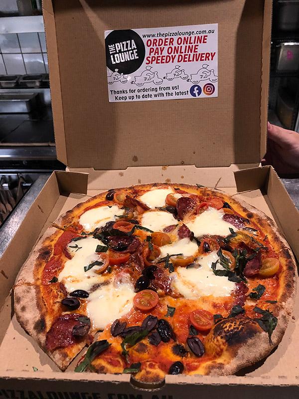 custom pizza in pizza box
